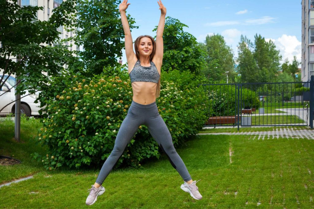 Jumping Jacks exercise to reduce hip and thigh fat